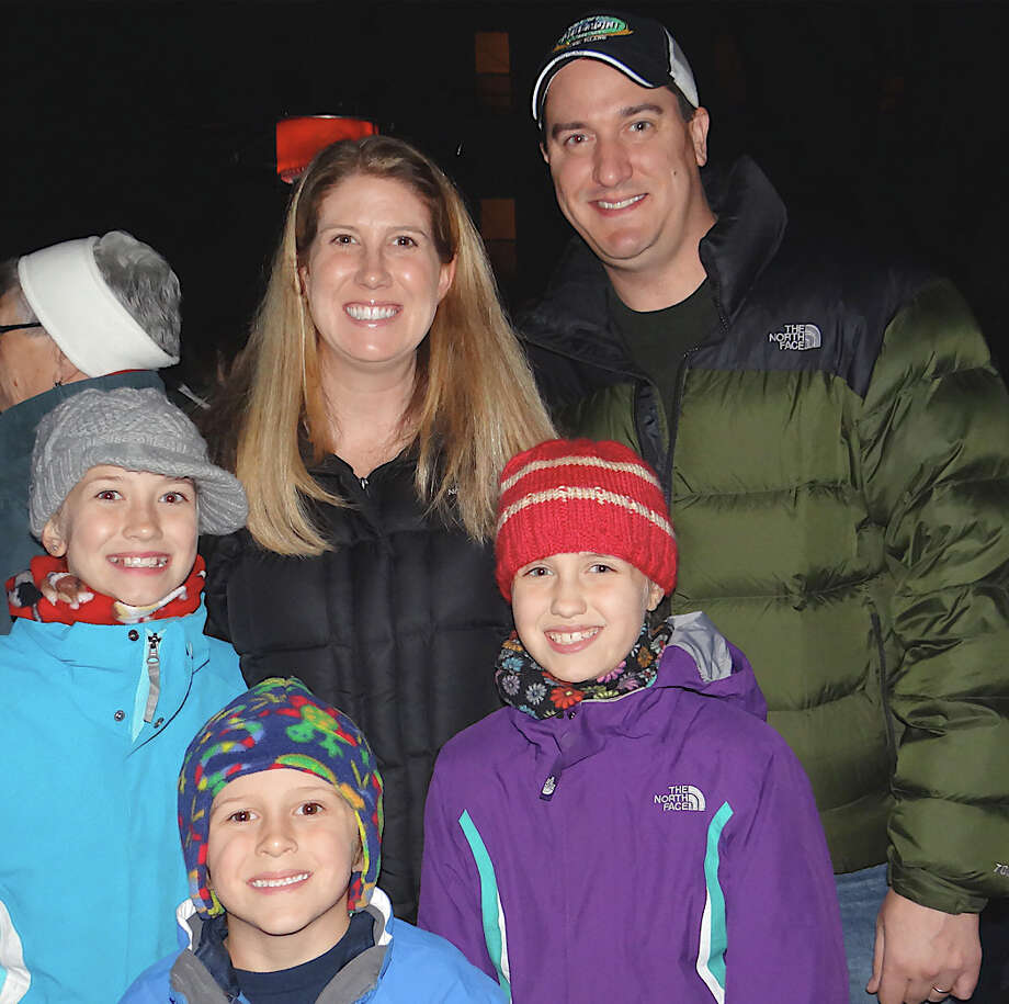 The Baranosky Family of Fairfield -- Lilly, 11, Jeanne, William, 5, Grace, 9, and B.J. -- at the Papageorge family's house lighting Saturday. Photo: Mike Lauterborn / Fairfield Citizen contributed
