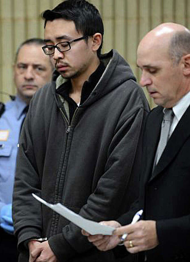 Fairfield resident William Dong, 22, with Assistant Public Defender Kevin Williams, is arraigned last week at Milford Superior Court on weapons charges following an incident at the University of New Haven. Photo: File Photo / Fairfield Citizen