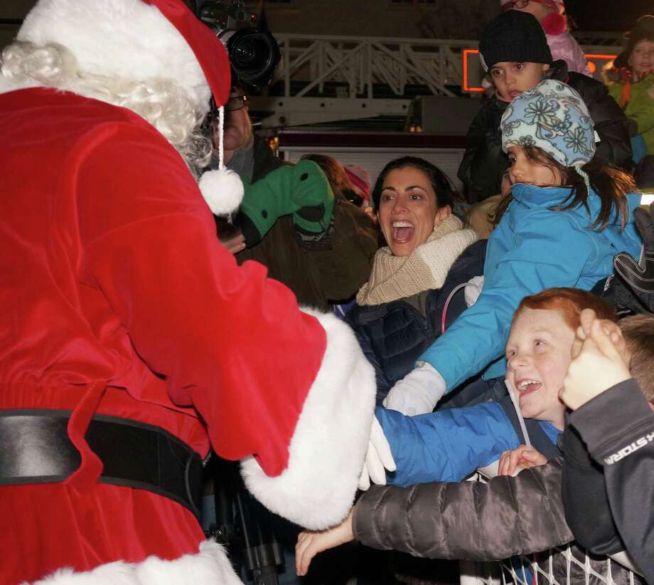 Santa and Mrs. Claus, along with Rudloph, Frosty and a couple of elves, caught a ride on a firetruck to the town's Christmas tree lighting Saturday. Photo: Genevieve Reilly / Fairfield Citizen