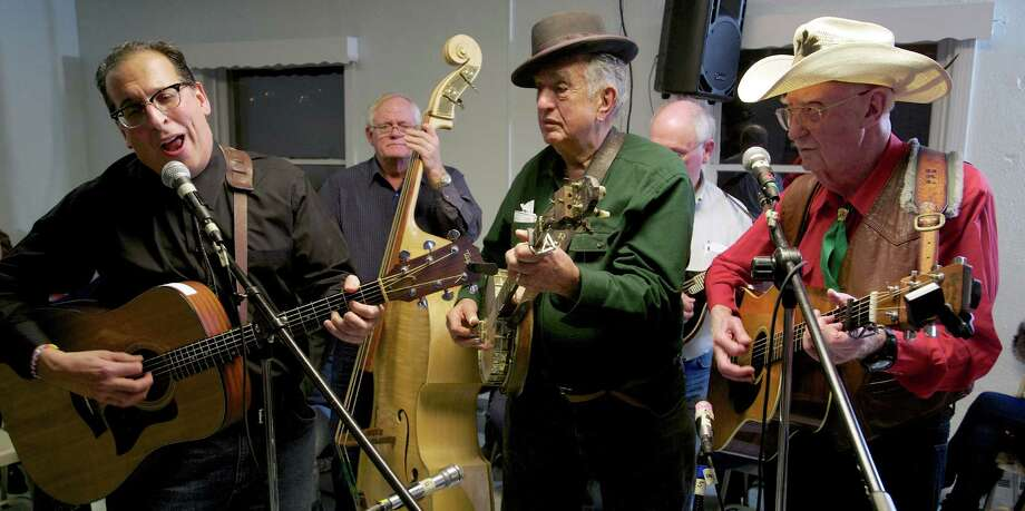 Paul Fenick, of Brookfield, left, plays at the monthly Pasta Jam at the United Methodist Church, in Newtown, Conn, on Saturday December 7, 2013.  Roger Sprung, of Newtown, middle, and Hal Wylie, right, of Monroe, NJ, look on. Photo: H John Voorhees III / The News-Times Freelance