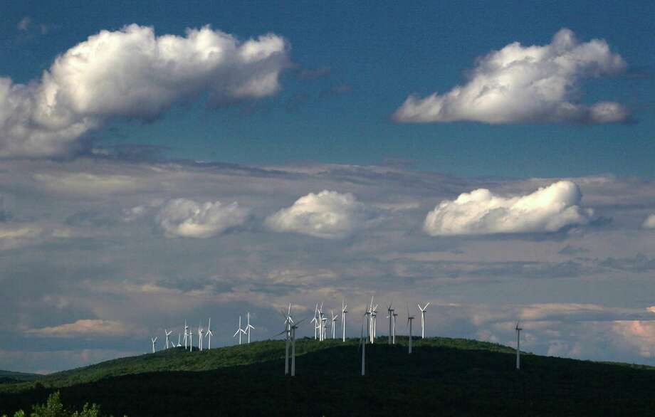 In this photo made in July, 2009, a wind farm stands on Stetson Mountain in Range 8, Township 3, Maine. Maine can meet its ambitious goal of generating 300,000 megawatts of power from wind without having a serious impact on the state's wildlife, according to a new report by one of the state's leading environmental groups. Photo: Robert F. Bukaty, AP / AP