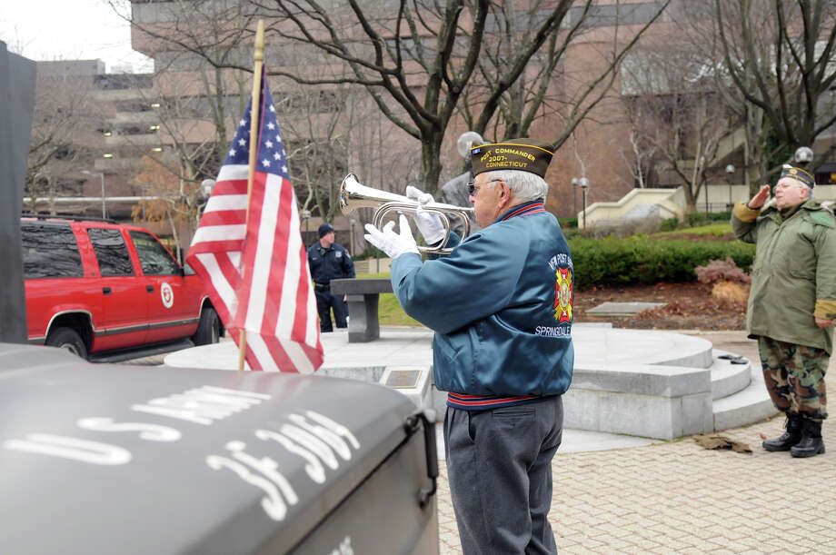 James Santangelo, commander of the Springdale VFW Post 9617, plays Taps as the Post hosts a service to remember the attack on Pearl Harbor 72 years ago at Veteran's Park in Stamford, Conn., Dec. 8, 2013. Photo: Keelin Daly / Stamford Advocate Freelance
