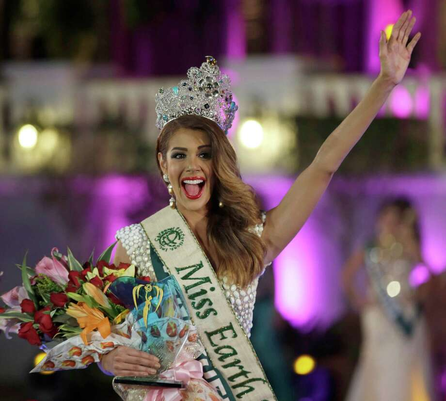 Miss Venezuela Alyz Henrich, waves to the crowd shortly after being crowned Miss Earth 2013 in ceremony Saturday evening Dec. 7, 2013 at a housing resort at suburban Alabang, east of Manila, Philippines. Henrich won over 88 beauty contestants from around the world. Miss Earth, now on its 13th year, is the only beauty pageant with a unique theme to save Mother Earth. Photo: Bullit Marquez, AP / AP2013
