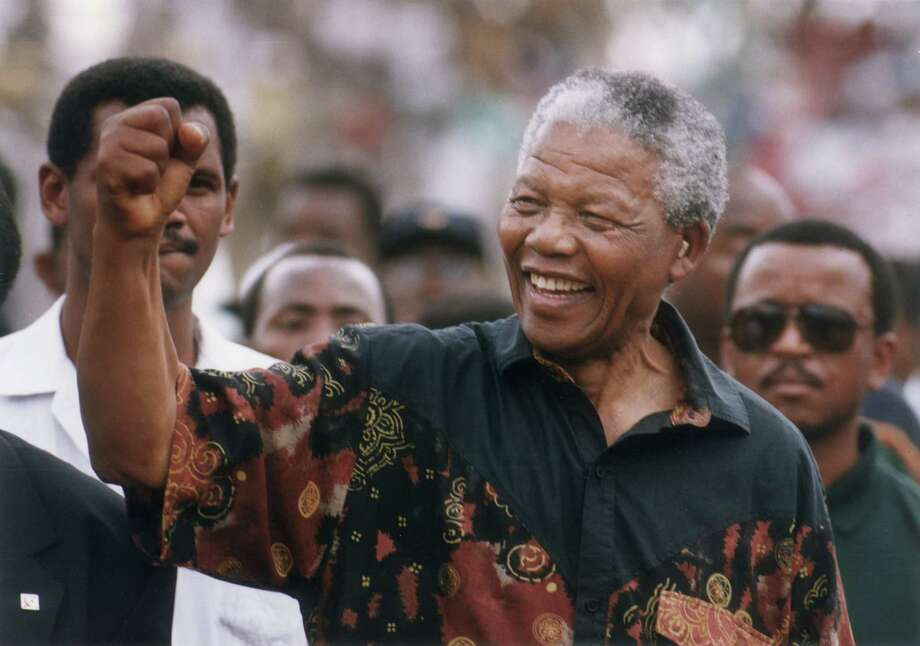 This file photo from 1994 shows Nelson Mandela.  Mandela, the former South African president and Nobel Peace Prize laureate who waged a long and ultimately victorious struggle against apartheid, died on Thursday, Dec. 5, 2013, South African President Jacob Zuma said. He was 95.  Photo: JERRY HOLT, AP / AP1997