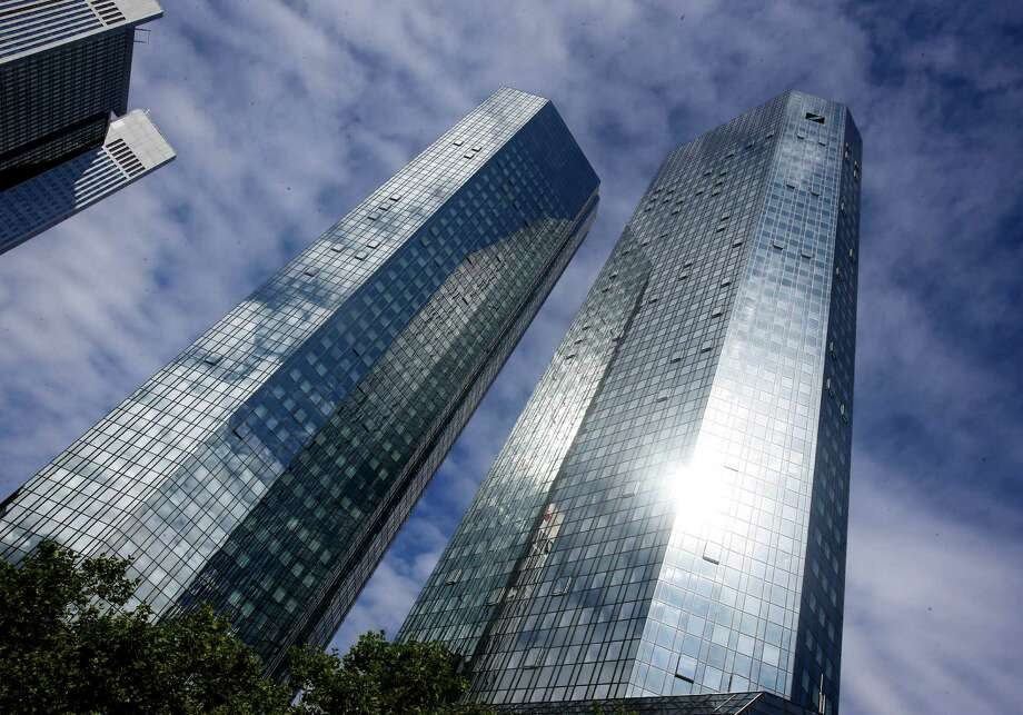 In this July 30, 2013 file photo the headquarters of Deutsche Bank are pictured in Frankfurt, GermanyThe European Commission has fined a group of major global banks a total of 1.7 billion euros (US dollar 2.3 billion) for colluding to profit from the interest rates market as it was announced Wednesday, Dec. 4, 2013. The banks, which includes the Deutsche Bank are accused of manipulating for years European and Japanese benchmark interest rates that affect hundreds of billions of dollars in contracts globally, from mortgages to credit card bills. Photo: Michael Probst, AP / AP
