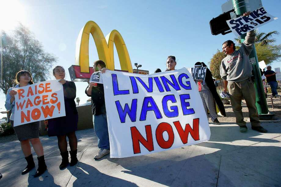 Nearly 50 protesters rally against low wages for fast-food workers, in front of a McDonald's Thursday, Dec. 5, 2013, in Phoenix. Photo: Ross D. Franklin, AP / AP2013