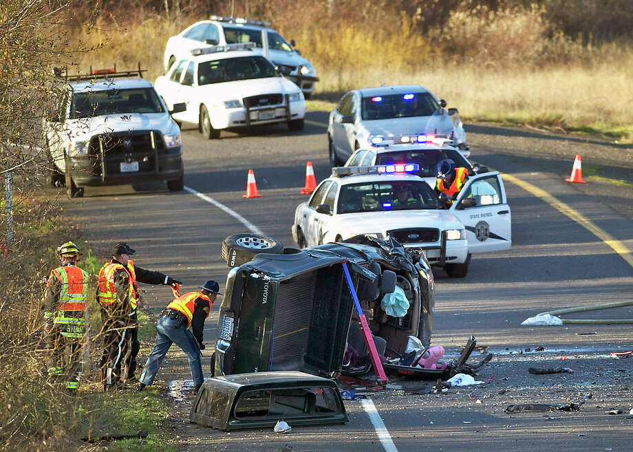 In this Dec. 4, 2013 photo, crews respond to an accident in Vancouver, Wash. Caran Johnson who regularly monitors police scanner traffic unknowingly live-tweeted about her husband's death in the freeway crash. Photo: Zachary Kaufman, AP / AP2013