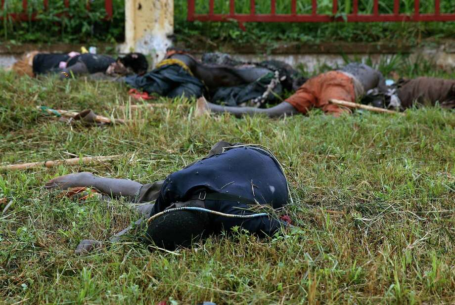 Bodies lay in the streets of Bangui, Central African Republic, Friday Dec. 6 2013, a day after gun battles between Seleka soldiers and Christian militias left over 100 dead and scores wounded. To try to put an end to sectarian violence, the UN security council passed a motion allowing French troops to deploy in the country in order to protect civilians and insure security by all necessary means. Photo: Jerome Delay, AP / AP2013