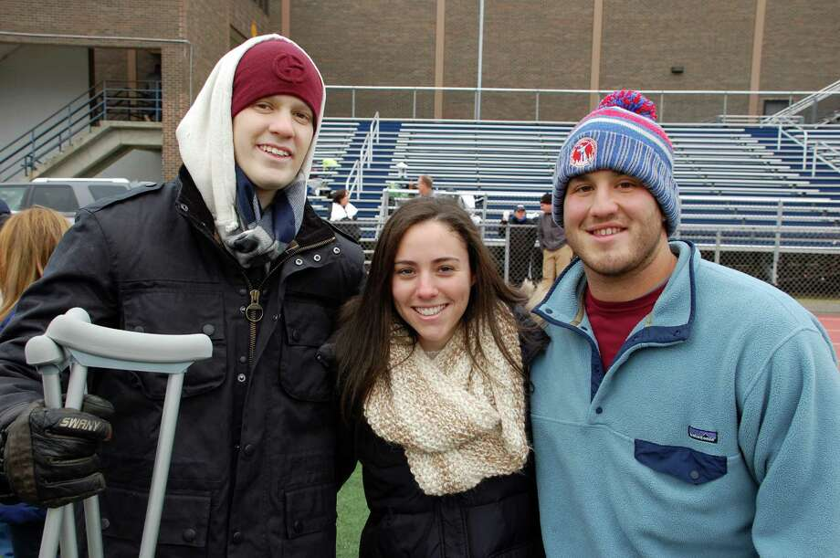 Former Staples High lacrosse player Nate Greenberg, left, recently diagnosed with Ewing Sarcoma, with friends  Allie Silvershein of Warren, N.J., and Rob Santangelo of Rye, N.Y., at Nate's Knockout Challenge staged Sunday at Staples to support cancer research. Both friends are fellow students with Greenberg at Union College. Photo: Jarret Liotta / Westport News contributed