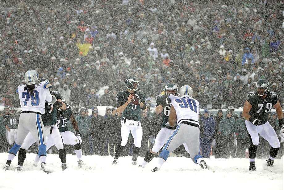 Philadelphia Eagles' Nick Foles looks to pass during the first half of an NFL football game against the Detroit Lions, Sunday, Dec. 8, 2013, in Philadelphia. Photo: Matt Rourke, Associated Press