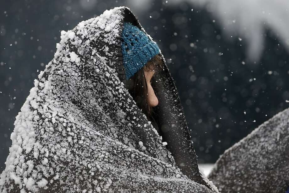 A fan at Lincoln Financial Field is covered with snow during the first half of an NFL football game between the Philadelphia Eagles and the Detroit Lions, Sunday, Dec. 8, 2013, in Philadelphia. Photo: Matt Rourke, Associated Press