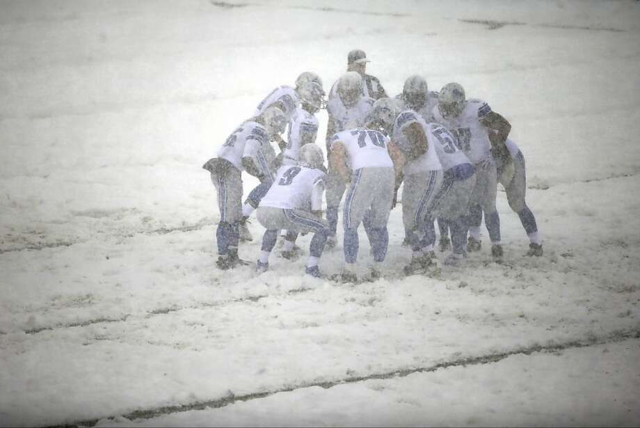 Detroit Lions quarterback Matthew Stafford (9) huddles with his team during a snow storm in the first half of an NFL football game against the Philadelphia Eagles, Sunday, Dec. 8, 2013, in Philadelphia.  Photo: Matt Rourke, Associated Press