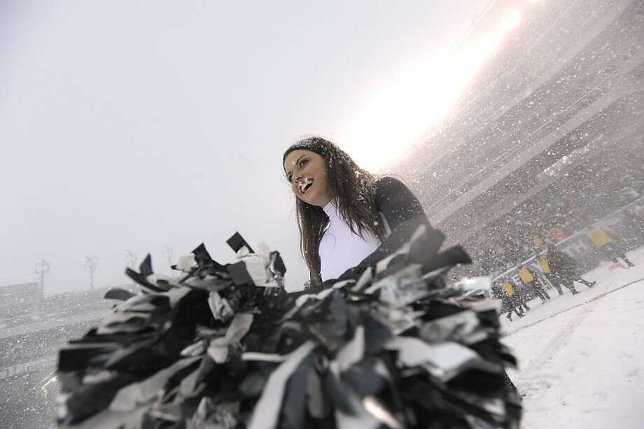 A Philadelphia Eagles' cheerleader performs during the first half of an NFL football game, Sunday, Dec. 8, 2013, in Philadelphia.  Photo: Michael Perez, Associated Press