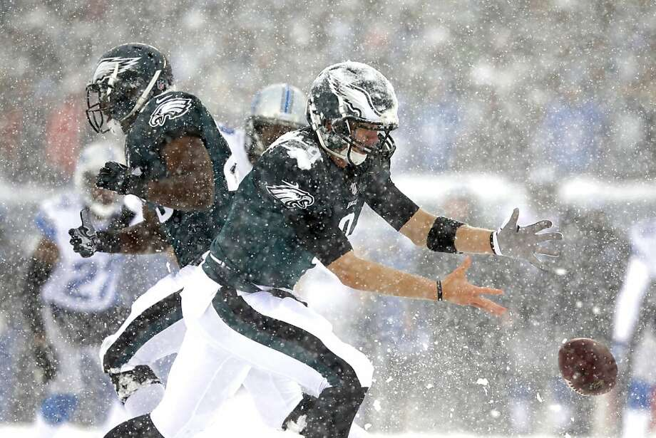 In the snow, Philadelphia Eagles' Nick Foles cannot hang onto the ball during the first half of an NFL football game against the Detroit Lions, Sunday, Dec. 8, 2013, in Philadelphia. Photo: Michael Perez, Associated Press