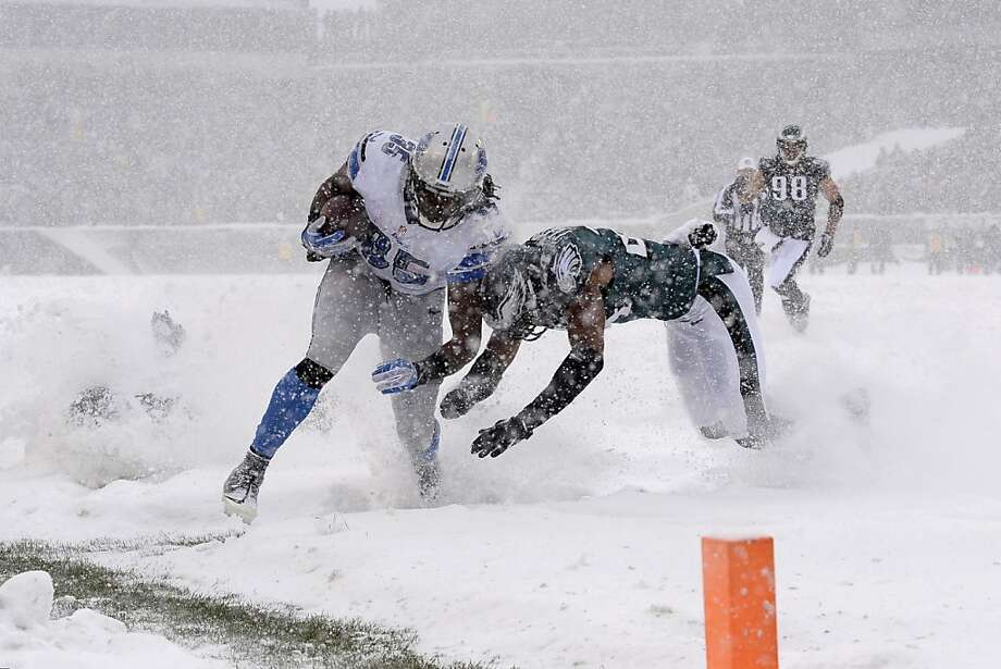 Detroit Lions' Joique Bell, left, is tackled by Philadelphia Eagles' Bradley Fletcher during the first half of an NFL football game, Sunday, Dec. 8, 2013, in Philadelphia. Photo: Michael Perez, Associated Press