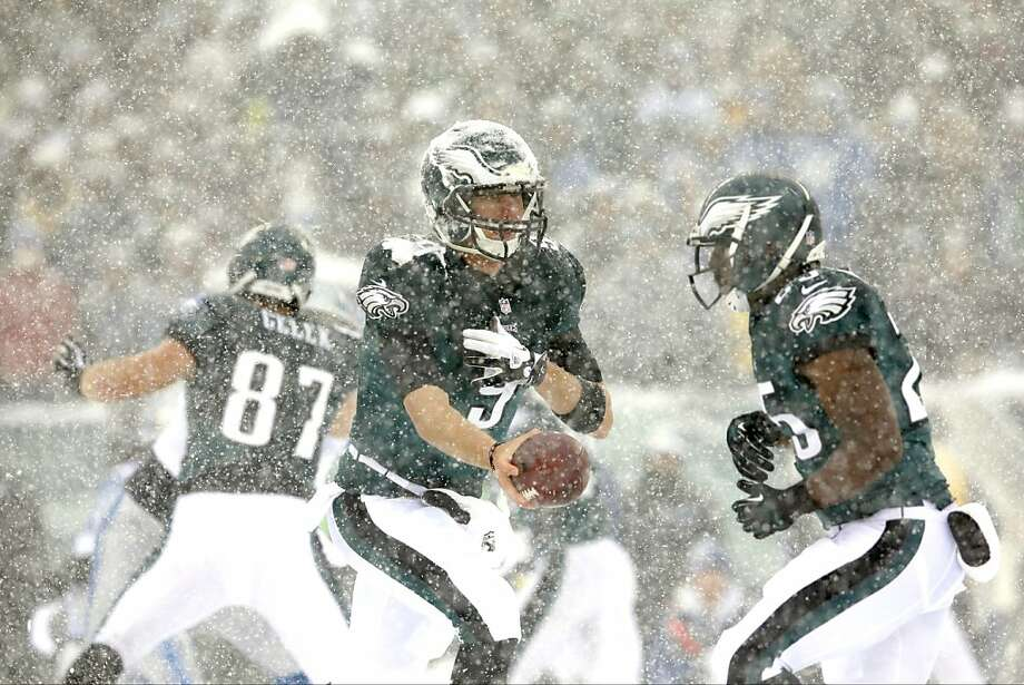 Philadelphia Eagles' Nick Foles, left, moves to hand off to LeSean McCoy during the first half of an NFL football game against the Detroit Lions, Sunday, Dec. 8, 2013, in Philadelphia.  Photo: Michael Perez, Associated Press