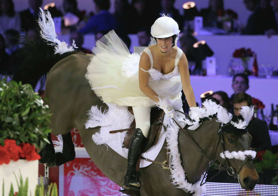 "American show jumper Jessica Springsteen, daughter of rock star Bruce Springsteen, rides her horse Wotsamillion during the equestrian ""Style and competition for Amade""  in Villepinte, east of Paris, Saturday, Dec. 7, 2013. Photo: AP"