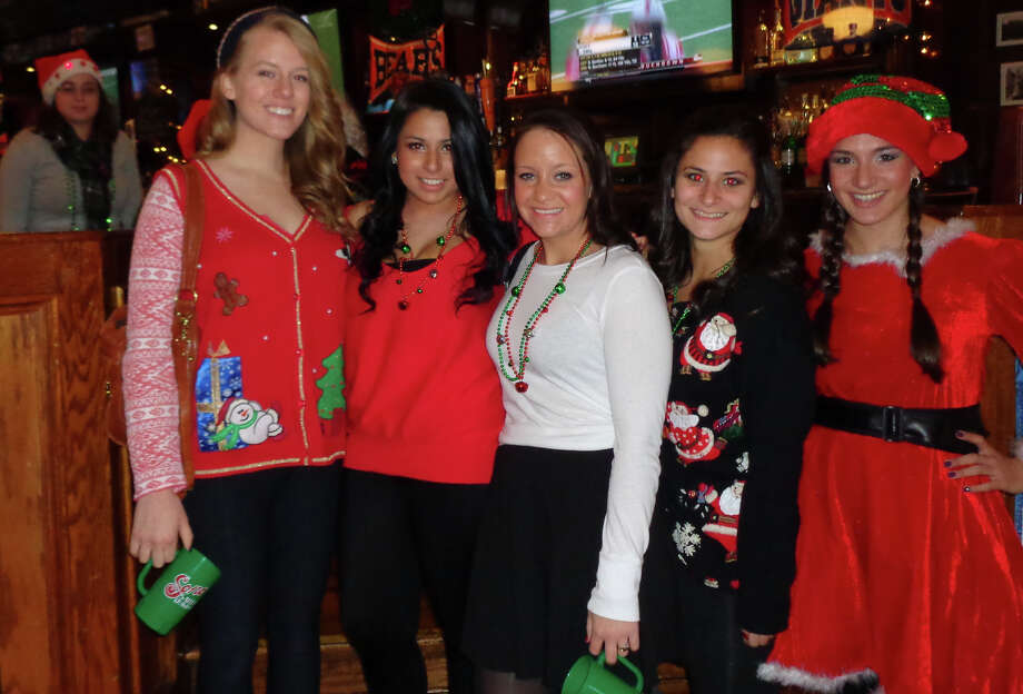A group of students from Sacred Heart University in Fairfield decided to party Saturday before Finals Week began by dressing in holiday attire and participating in the first-ever SoNo Santa Crawl. They are, from left, Maddy Murcott of Bridgeport; Vanessa Montoya of Westchester, N.Y.; Andrea Coronis of Boston; Paige Estrella of Iselin, N.J., and Kimberly Woodruff of Morris County, N.J. Photo: Meg Barone / Norwalk Citizen contributed