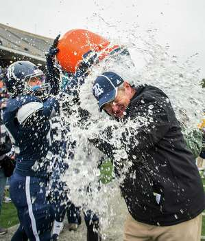 Rice head coach David Bailiff is doused by his players after the Owls defeated Marshall in the C-USA championship football game at Rice Stadium, Saturday, Dec. 7, 2013, in Houston.   Rice won the game 41-24 to capture their first outright conference title since winning the 1957 SWC championship. Photo: Smiley N. Pool, Houston Chronicle / © 2013  Houston Chronicle