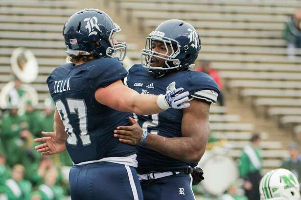 Rice tight end Connor Cella (87) celebrates with running back Charles Ross (12) after scoring on a 8-yard touchdown pass during the second half of the C-USA championship football game at Rice Stadium, Saturday, Dec. 7, 2013, in Houston.   Rice won the game 41-24 to capture their first outright conference title since winning the 1957 SWC championship.