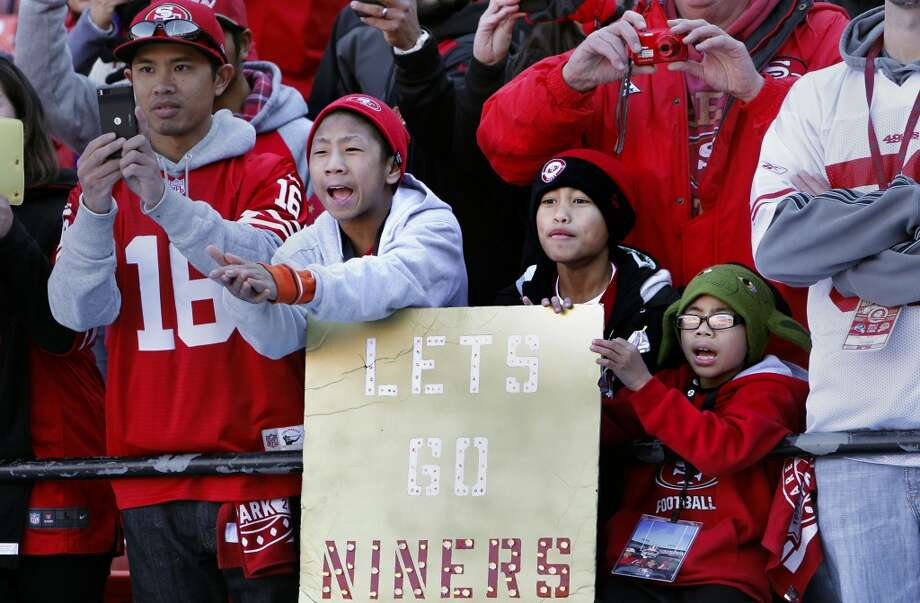 49ers fans E.J. Domingo, 11, Jaden Trias, 10 and Jeremie Domingo, 8 yell to their favorite players during warm ups as the San Francisco 49ers prepare to take on the Seattle Seahawks at Candlestick Park on Sunday Dec. 8, 2013, in San Francisco, Ca. Photo: The Chronicle