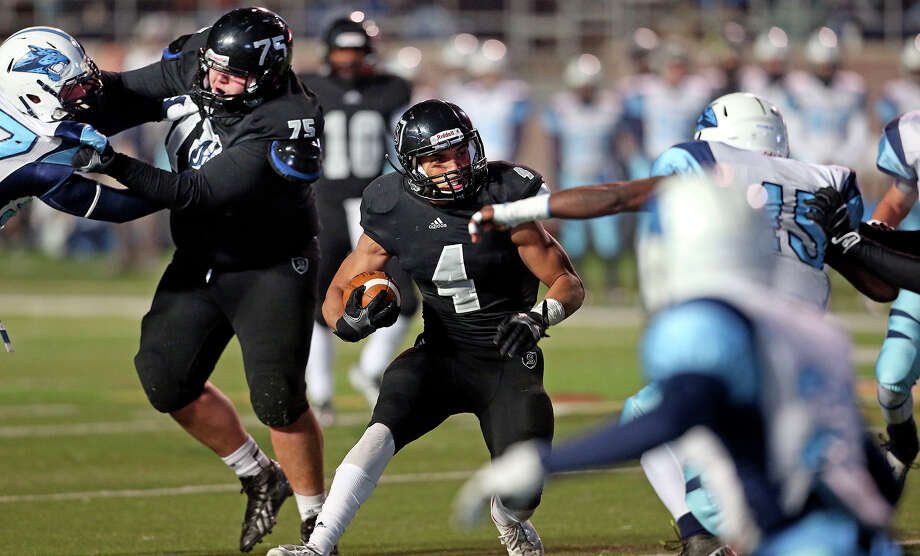 Justin Stockton twists through the field for the Knights as Johnson beats Steele 42-41 at Bobcat Stadium in the 5A quarterfinals on December 7, 2013. Photo: Tom Reel, San Antonio Express-News