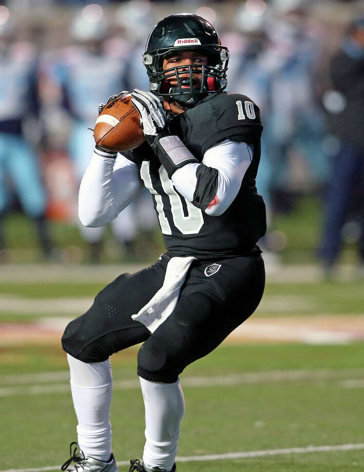 LG Williams gets set to throw for the Knights as Johnson beats Steele 42-41 at Bobcat Stadium in the 5A quarterfinals on December 7, 2013. Photo: Tom Reel, San Antonio Express-News