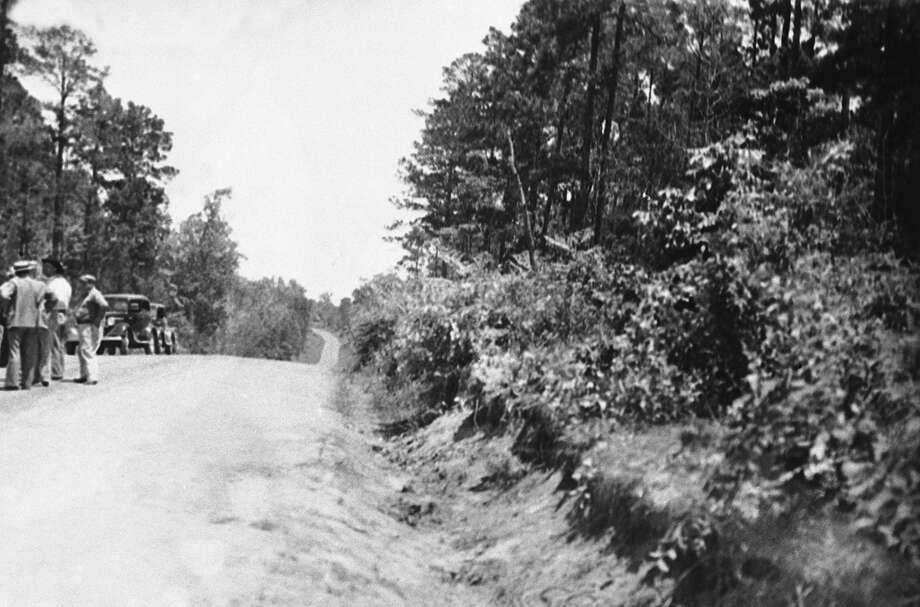 Clyde Barrow and Bonnie Parker were met by a fusillade of shots fired by a posse of six officers, led by Sheriff Henderson Jordan of Bienville Parish, La., and former Texas ranger Frank Hamer, as the pair of long-sought bandits drove up this hill, May 28, 1934. The officers were secluded in a clump of bushes beside the highway. Photo: Associated Press