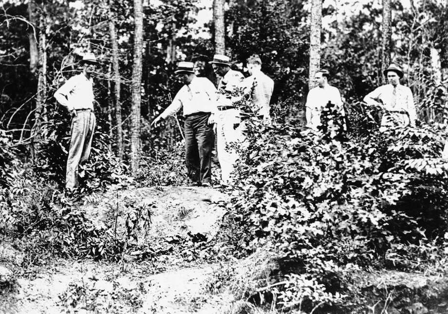 Texas and Louisiana officers gathered in this heavily wooded sector of Louisiana near Arcadia, May 24, 1934, and then laid down a barrage of gunfire which took the lives of Clyde Barrow and Bonnie Parker. The officers first called on Barrow to halt as he drove his automobile 85 miles an hour down the road. As Barrow reached for his pistol and machine gun, the officers cut loose from the spot to which the officer is pointing. Photo: Associated Press