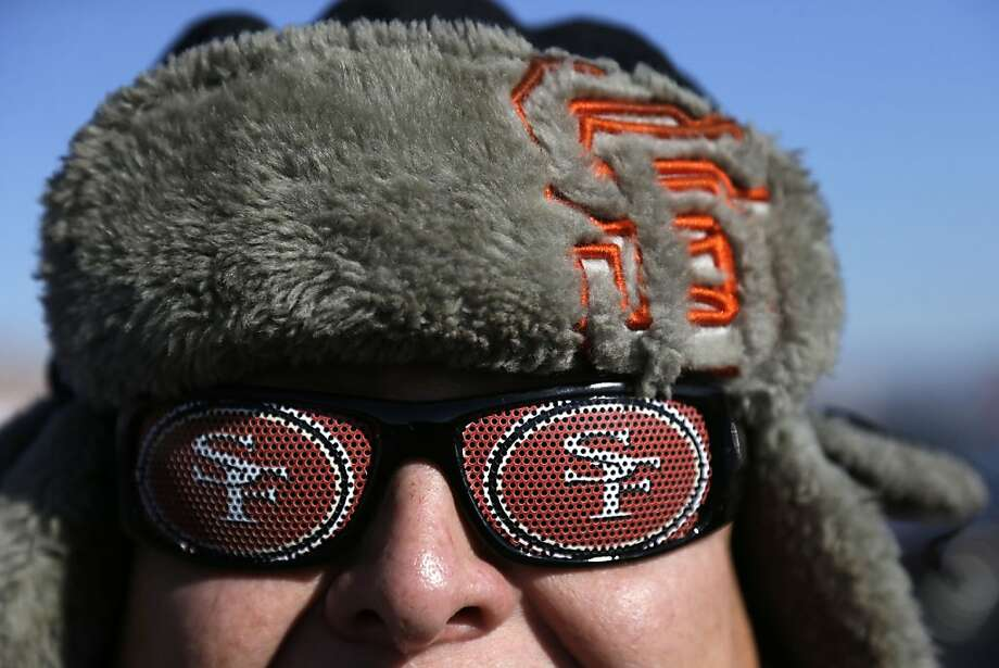 A San Francisco 49ers fan in the cold outside Candlestick Park before an NFL football game against the Seattle Seahawks, Sunday, Dec. 8, 2013, in San Francisco. (AP Photo/Marcio Jose Sanchez) Photo: Marcio Jose Sanchez, Associated Press