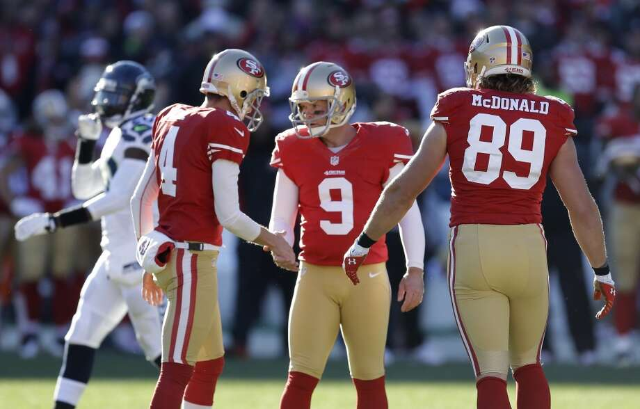 San Francisco 49ers kicker Phil Dawson (9) is greeted by holder Andy Lee (4) after kicking a field goal in the first half of an NFL football game against the Seattle Seahawks, Sunday, Dec. 8, 2013, in San Francisco. At right is San Francisco 49ers tight end Vance McDonald. (AP Photo/Ben Margot) Photo: Ben Margot, AP