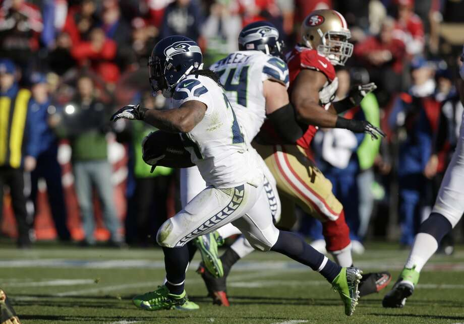 Seattle Seahawks running back Marshawn Lynch carries the ball in the first half of an NFL football game against the San Francisco 49ers, Sunday, Dec. 8, 2013, in San Francisco. (AP Photo/Marcio Jose Sanchez) Photo: Marcio Jose Sanchez, AP