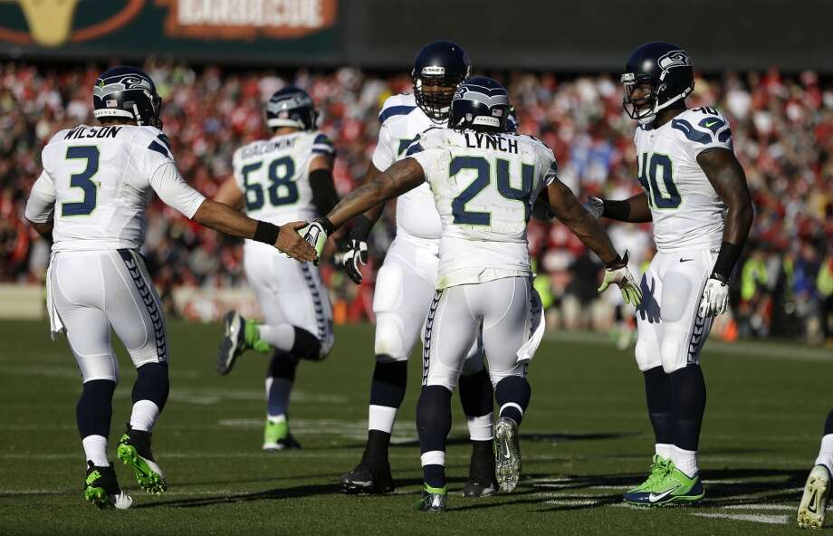Seattle Seahawks running back Marshawn Lynch (24) is greeted by quarterback Russell Wilson (3) after a touchdown in the first half of an NFL football game against the San Francisco 49ers, Sunday, Dec. 8, 2013, in San Francisco. (AP Photo/Ben Margot) Photo: Ben Margot, AP