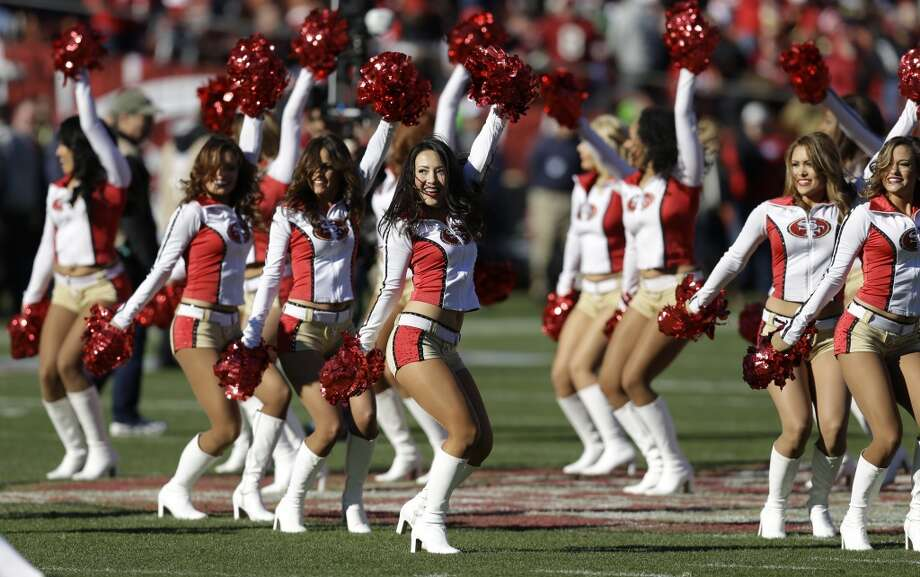 San Francisco 49ers Gold Rush cheerleaders peform in the first half of an NFL football game between the San Francisco 49ers and the Seattle Seahawks, Sunday, Dec. 8, 2013, in San Francisco. (AP Photo/Ben Margot) Photo: Ben Margot, AP