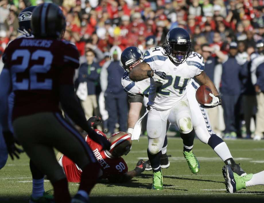 Seattle Seahawks running back Marshawn Lynch (24) rushes for a touchdown in the first half of an NFL football game against the San Francisco 49ers, Sunday, Dec. 8, 2013, in San Francisco. (AP Photo/Marcio Jose Sanchez) Photo: Marcio Jose Sanchez, AP