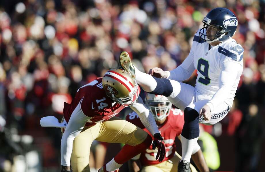 San Francisco 49ers' Kassim Osgood, left, collides with Seattle Seahawks kicker Jon Ryan, right, after Osgood blocked Ryan's punt in the first half of an NFL football game on Sunday, Dec. 8, 2013, in San Francisco. (AP Photo/Marcio Jose Sanchez) Photo: AP