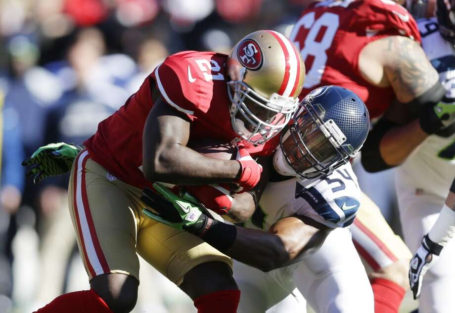 San Francisco 49ers running back Frank Gore (21) is tackled by Seattle Seahawks' middle linebacker Bobby Wagner (54) in the first half of an NFL football game on Sunday, Dec. 8, 2013, in San Francisco. (AP Photo/Marcio Jose Sanchez) Photo: ASSOCIATED PRESS
