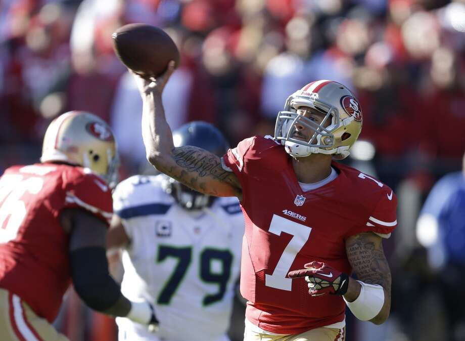 San Francisco 49ers quarterback Colin Kaepernick throws the ball as Seattle Seahawks defensive end Red Bryant (79) looks on in the first half of an NFL football game on Sunday, Dec. 8, 2013, in San Francisco. (AP Photo/Ben Margot) Photo: AP