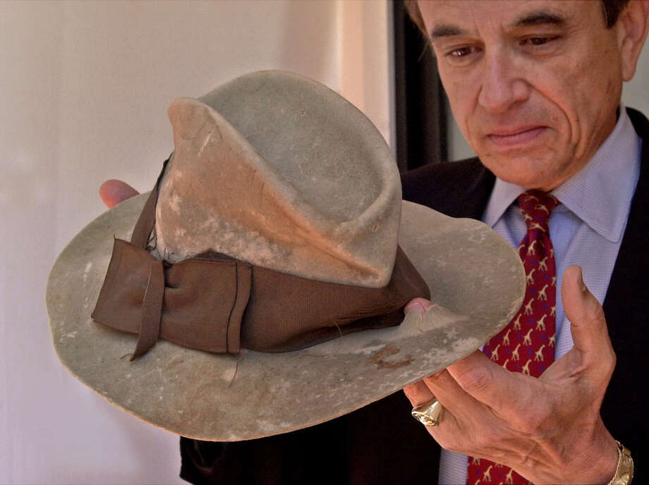 Greg Martin, director of the Arms & Armor Dept. at Butterfields auction house in San Francisco, puts his finger through a bullet hole of the blood-splattered hat worn by Clyde Barrow in 1934 when he and Bonnie Parker were gunned down by authorities. The hat and other Bonnie and Clyde memorabilia were auctioned in 2000 in San Francisco. Photo: BEN MARGOT, Associated Press / AP