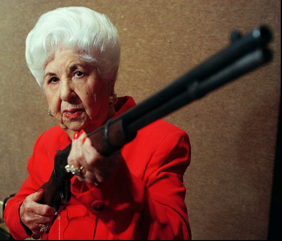 Marie Barrow, sister of outlaw Clyde Barrow, holds her late brother's Winchester rifle in 1997, at a preview of the Bonnie and Clyde collectors auction in San Francisco.  The rifle was Clyde Barrow's first firearm. Photo: LACY ATKINS, Associated Press / AP