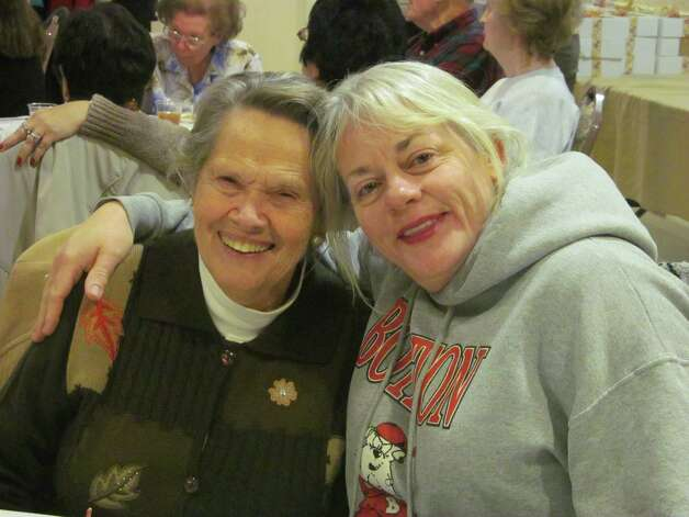Bright Horizons Adult Day Services members and their loved ones enjoyed the company and entertainment at the annual Thanks for Caregiving event on Nov. 26. Each year the event is held to thank caregivers for their dedication. Here, Alice Ellett met with her friend Wendy. (Submitted photo)