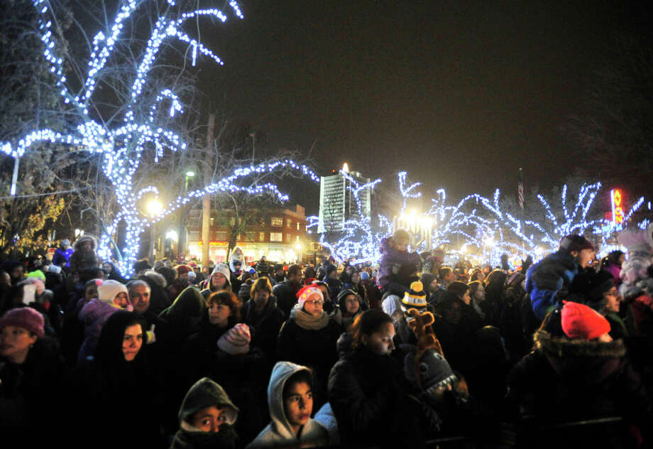 Spectators watch the tree-lighting ceremony at Latham Park during the Heights and Lights event in downtown Stamford, Conn., on Sunday, Dec. 8, 2013. Photo: Jason Rearick / Stamford Advocate