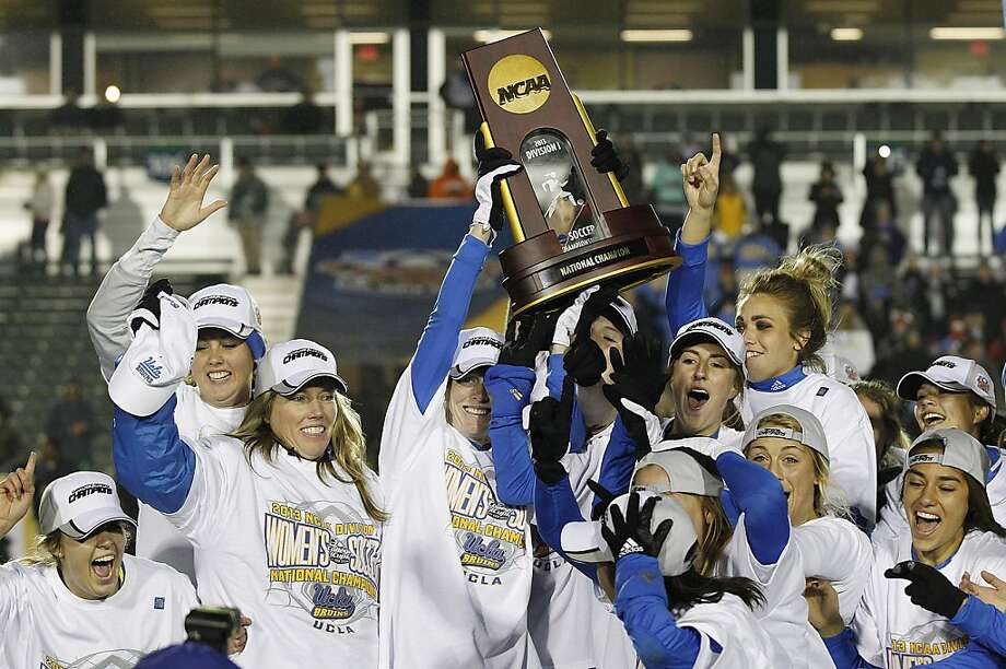 UCLA players and coach Amanda Cromwell (second from left) celebrate the program's first national title after beating Florida State 1-0 in overtime. Photo: Ellen Ozier, Associated Press