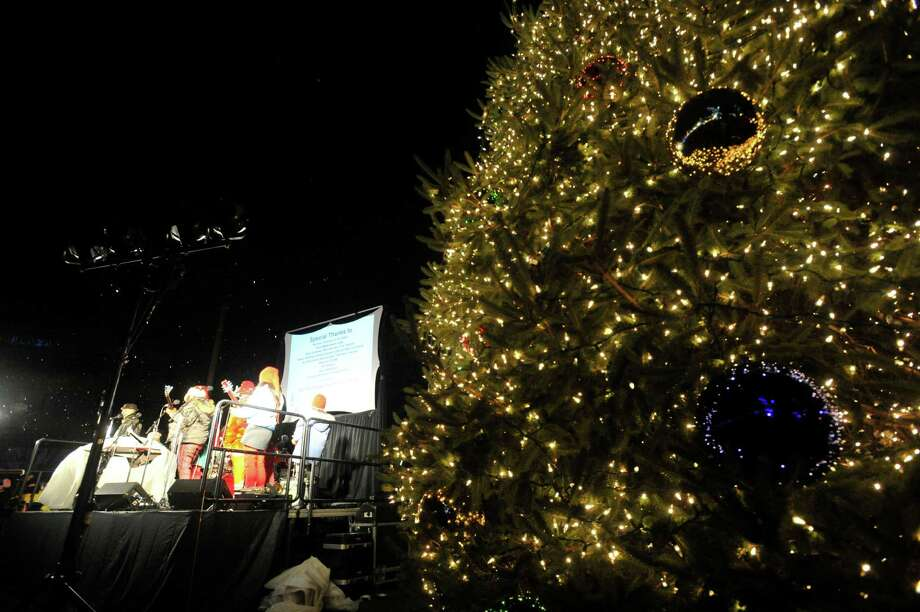 The Swingset Mamas perform on stage after the tree lighting ceremony at Latham Park during the Heights and Lights event in downtown Stamford, Conn., on Sunday, Dec. 8, 2013. Photo: Jason Rearick / Stamford Advocate
