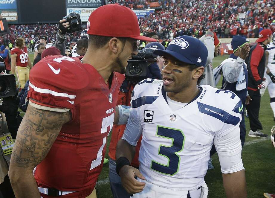 San Francisco 49ers quarterback Colin Kaepernick, left, talks with Seattle Seahawks quarterback Russell Wilson (3) after an NFL football game, Sunday, Dec. 8, 2013, in San Francisco. The 49ers beat the Seahawks 19-17. (AP Photo/Marcio Jose Sanchez) Photo: Marcio Jose Sanchez, Associated Press