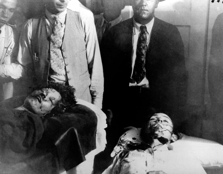 Bonnie Parker (left) and Clyde Barrow are shown at the morgue in Arcadia, La., on May 23, 1934. The bank robbers were ambushed by law enforcement officials who riddled their car with 167 bullets as they drove along a country road. Photo: Associated Press