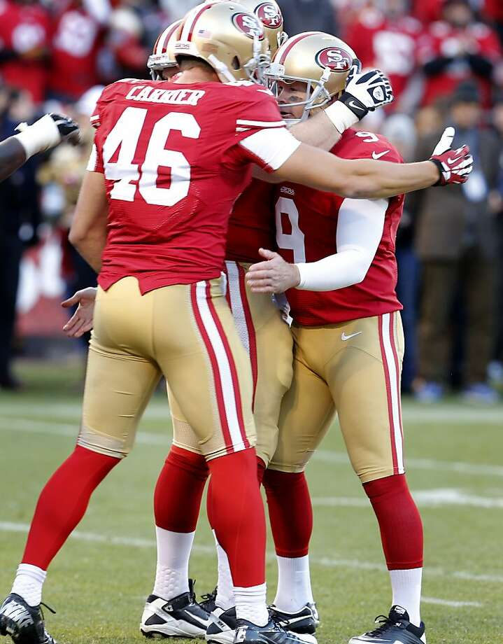 Kicker Phil Dawson (9) is congratulated by teammates after his game winning field goal. The San Francisco 49ers defeated the Seattle Seahawks 19-17 Sunday December 8, 2013 at Candlestick Park in San Francisco, Calif. Photo: Brant Ward, The Chronicle