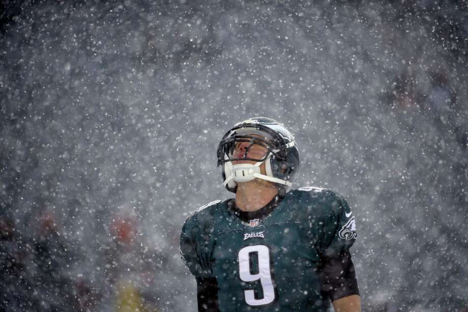 Philadelphia Eagles' Nick Foles warms up as snow falls before an NFL football game against the Detroit Lions, Sunday, Dec. 8, 2013, in Philadelphia. (AP Photo/Matt Rourke) Photo: Matt Rourke, STF / AP