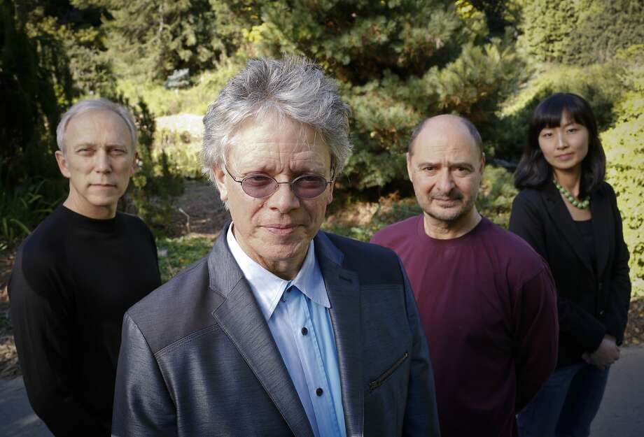 The Kronos Quartet, from left, Hank Dutt, David Harrington, John Sherba, and Sunny Yang, are seen on Thursday, Oct. 31, 2013 in San Francisco, Calif.  Harrington started the group 40 years ago. Photo: Russell Yip, The Chronicle