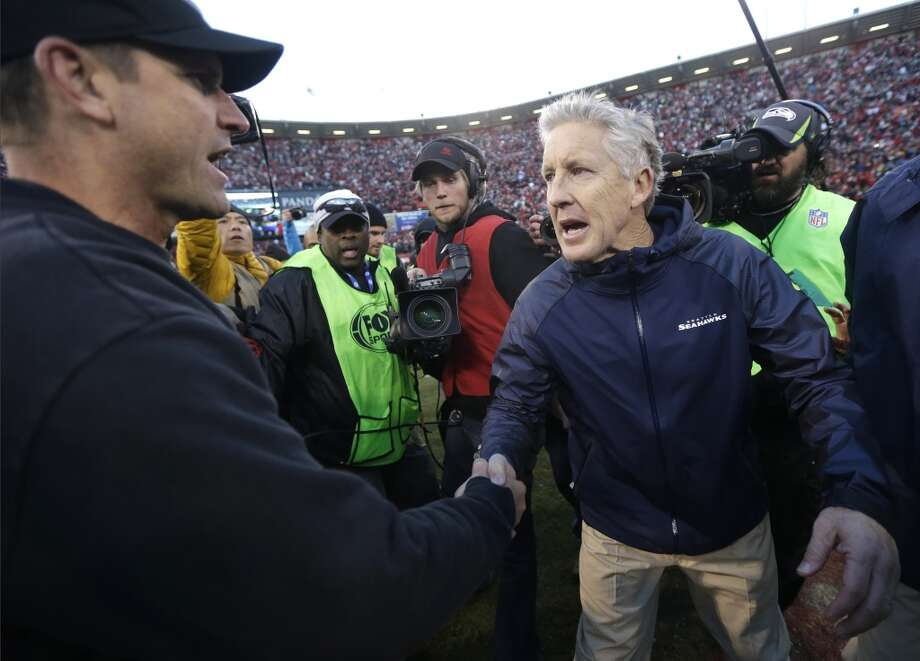 San Francisco 49ers head coach Jim Harbaugh, left, shakes hands with Seattle Seahawks head coach Pete Carroll, right, at the end of an NFL football game, Sunday, Dec. 8, 2013, in San Francisco. The 49ers defeated the Seahawks 19-17. (AP Photo/Marcio Jose Sanchez) Photo: Marcio Jose Sanchez, AP